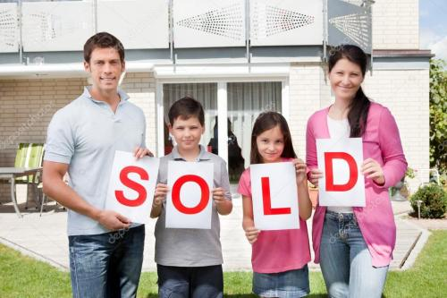 depositphotos 20231259-stock-photo-family-holding-a-sold-sign